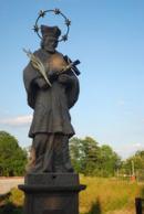 Detail sochy Jana Nepomuckého.