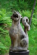 Dřevěná socha čínského leoparda.