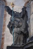 Jedna ze soch na sloupu sv. Jana Nepomuckého a zemských patronů.