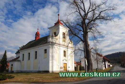 Kostel zasvěcený Archandělu Michaelovi z roku 1713.